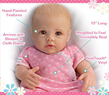 This lifelike So Truly Mine doll from The Ashton-Drake Galleries is crafted with RealTouch vinyl, has hand-painted features, arrives with a sleeper and cloth diaper, is weighted to feel incredibly real and is 15 inches long.