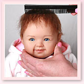 Ashton-Drake Galleries baby doll hair stying tip: gently comb the doll's hair in one direction, starting at the crown