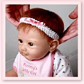 Ashton-Drake Galleries baby doll headband application tip: push the headband down until it's just right