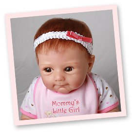 Ashton-Drake Galleries baby doll headband application tip: your doll is ready to be displayed