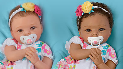 So Truly Mine doll photo gallery: two young girls holding a So Truly Mine baby doll dressed in pink
