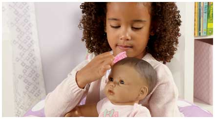 So Truly Mine doll photo gallery: a young girl brushing her So Truly Mine doll's hair