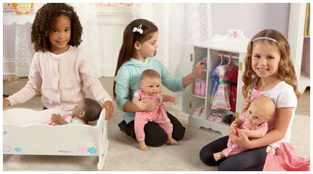 So Truly Mine doll photo gallery: three young girls in a bedroom with their So Truly Mine baby dolls