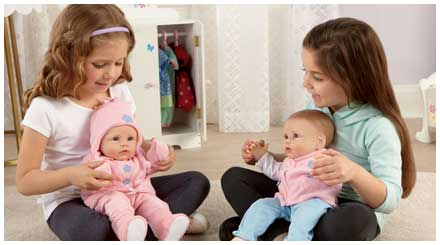 So Truly Mine doll photo gallery: two young girls holding their So Truly Mine baby dolls and playing on the floor of their bedroom